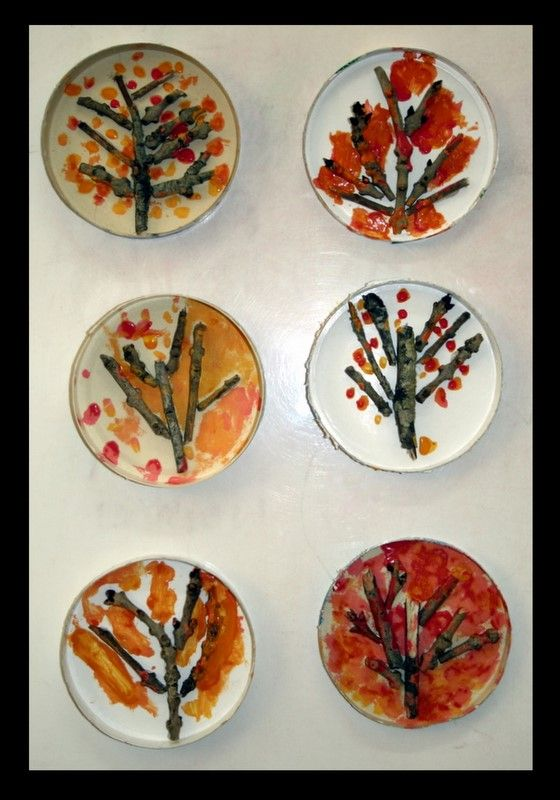 Lovely fall trees using twigs, glue, a small lid (for holding the design together) and paint.