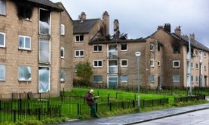 Glasgow smiles: how the city halved its murders by 'caring people into change'  Img: A man reads the newspaper in Easterhouse, Glasgow, once one of the most dangerous parts of Europe.