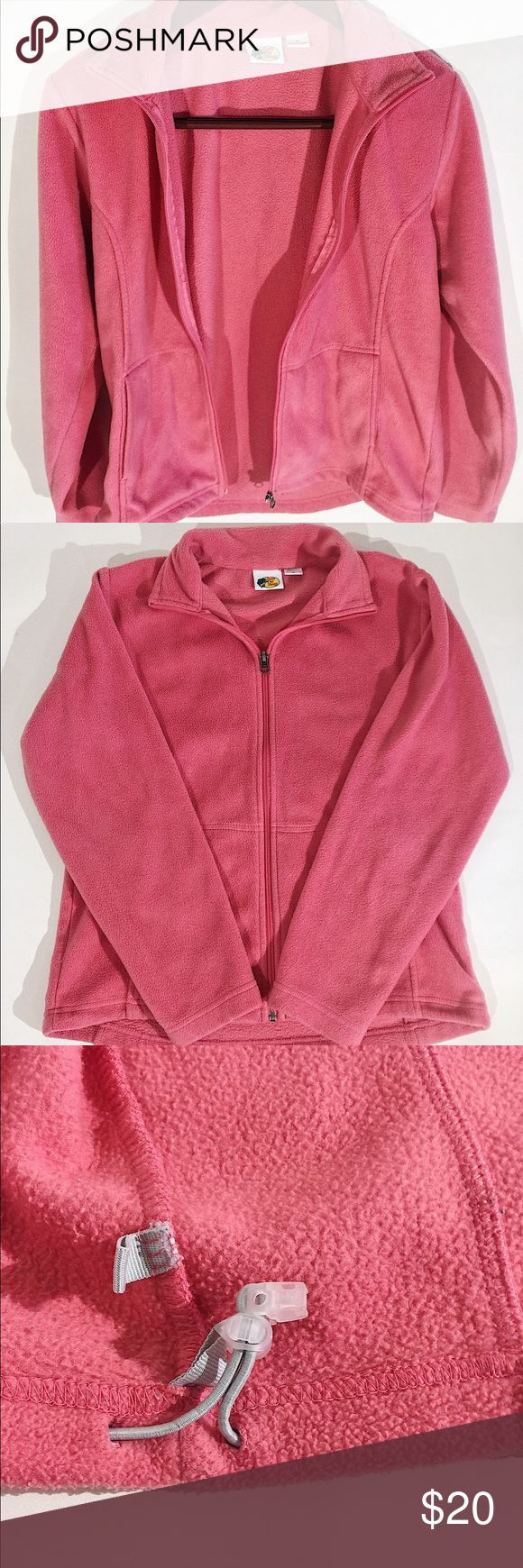 Women's Bass Pro Pink Fleece Jacket Size M This is a Coral/Pink full zip up fleece BassPro jacket.  It is very soft and comfortable.   It has a drawstring on the bottom of the jacket and two pockets in the front.  It is 100% polyester.  It measures approximately: 26 inches length, 20 inches wide, 23 1/2 inches sleeve. BassPro Jackets & Coats