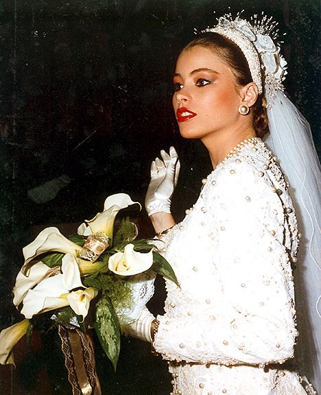 Sofia Vergara, just 18 at the time, holds a bouquet of lilies on her wedding day in 1991.