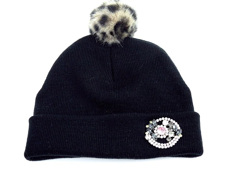 Another leopard faux fur PomPom beanie with a vintage inspired and delicately colored brooch.