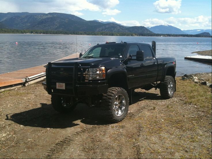 lifted-chevy-mud-truck-pics-hd-lifted-chevy-mudding---bagged-big-block-camo-gmc-mud-truck-blasts-awesome yes