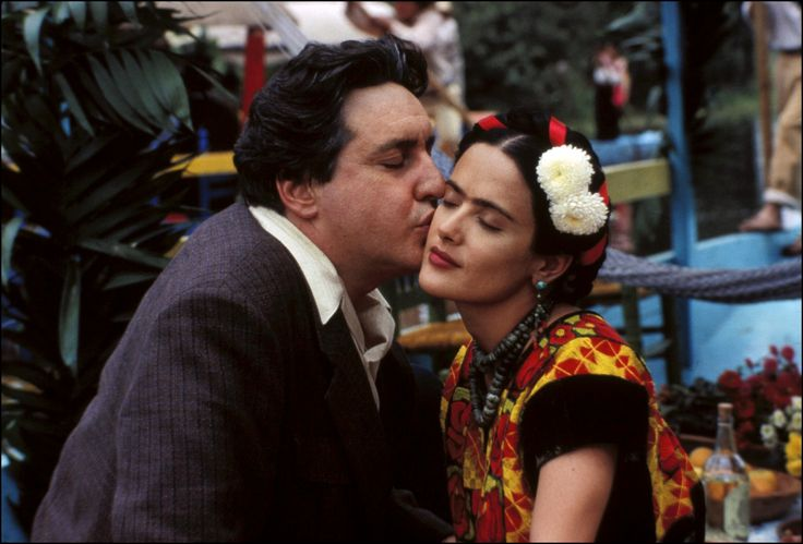 """Frida"" movie still, 2002.  L to R: Alfred Molina, producer/star Salma Hayek.  This project was circulating in Hollywood beginning in the late 1980s with names like Meryl Streep and Jessica Lange attached to it.  Hayek submitted her promo reel to be considered for the role of Frida Kahlo in 1992 and she was deemed ""too young""."