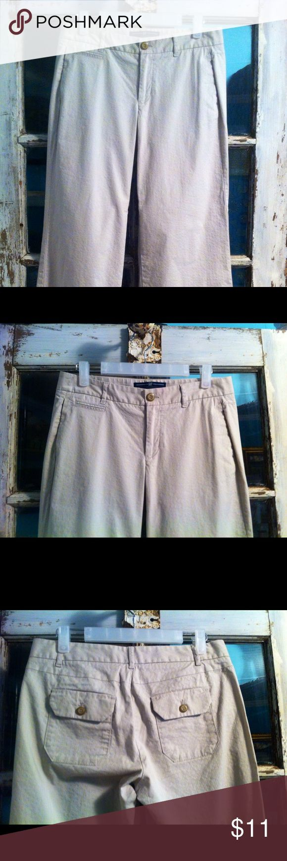 Gap Trouser Gap khakis.  97% cotton 3% spandex   Pockets in front.  Two flap pockets in back.  Great shape.  Inseam 29 GAP Pants Trousers