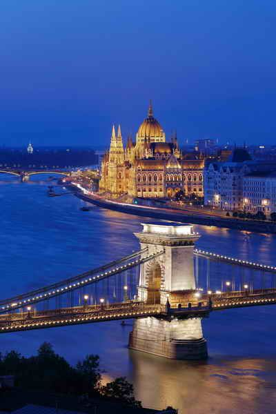 The illuminated Chain Bridge and Parliament in Budapest, Hungary.