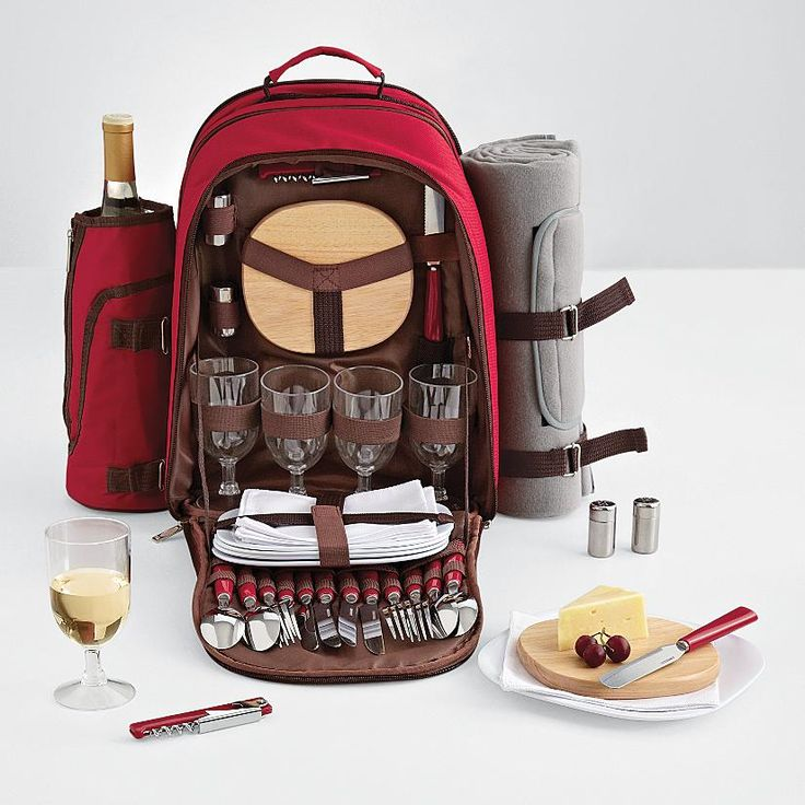 Picnic Backpack - RedEnvelope.com; Hosting a family picnic is as simple as filling our backpack with the family's favorite foods. The canvas pack is already loaded up with melamine plates, goblets, flatware, napkins for 4, plus a bread knife, wooden cutting board, salt & pepper shakers & a sommelier's corkscrew.