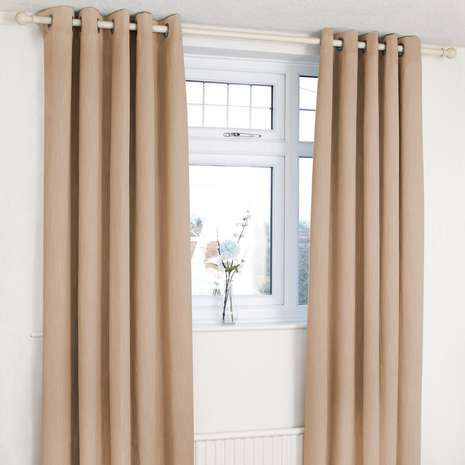 Crafted with a biscuit brown colourway and a subtle textured design, these eyelet curtains feature a blackout lining to exclude external light and regulate room...