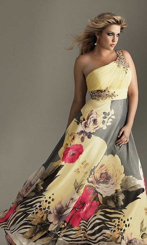Plus size fun.  Bold floral print with eye catching crystal embellishments.