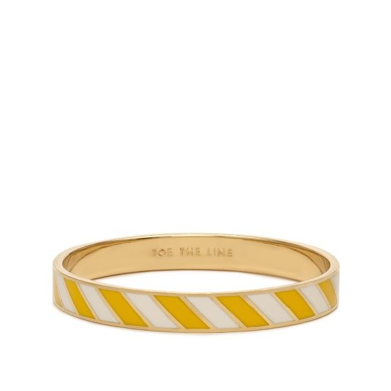 [Toe the Line Idiom bangle by Kate Spade, $58] Love it!  If you wear two of these (one upside down), you can create a chevron pattern. ;)