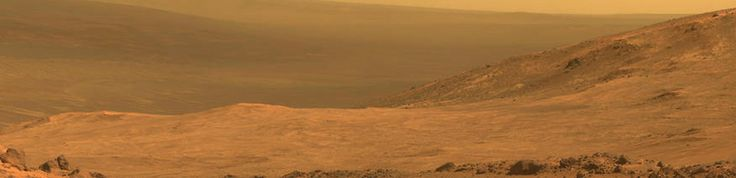 """MARATHON VALLEY OF MARS A view from NASA's Mars Exploration Rover Opportunity shows part of """"Marathon Valley,"""" a destination on the western rim of Endeavour Crater on the planet Mars, as seen from an overlook north of the valley in this NASA composite handout photo provided March 24, 2015. The scene combines four pointings of the rover's panoramic camera on March 13, 2015, on NASA's Mars Reconnaissance Orbiter ... More >>> © NASA/Reuters"""