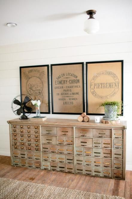 The entrance to the home is now a spacious foyer furnished with an antique sideboard and vintage accessories.