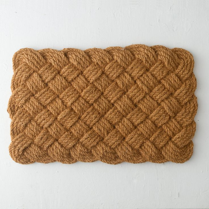 """A practical addition to mudrooms, patios, and porches, this woven mat is made from rugged, coco palm fiber that catches dirt before it enters the house.- Coco palm fiber- Indoor or outdoor use- Imported1""""H, 21.5""""W, 34""""L"""