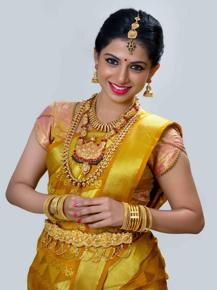 South Indian bride. Temple jewelry. Jhumkis.Yellow silk kanchipuram sari.Braid with fresh jasmine flowers. Tamil bride. Telugu bride. Kannada bride. Hindu bride. Malayalee bride.Kerala bride.South Indian wedding