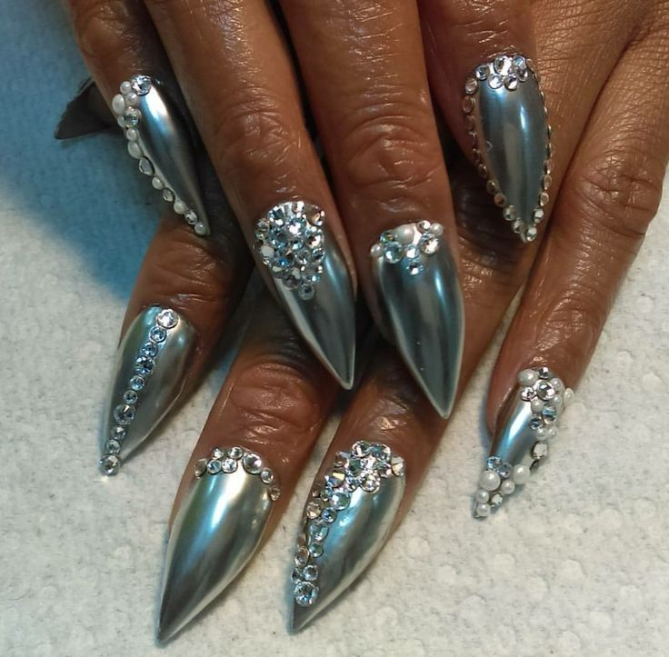 Chrome silver stiletto nails with gems