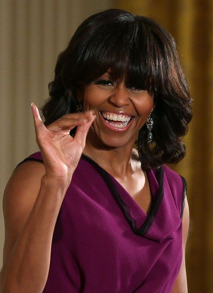 50 & Fabulous - First Lady Michelle Obama. Is our First Lady throwin up the pinkie???