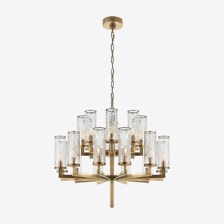 The Liaison Double Tier Chandelier in Antique Burnished Brass with Crackle Glass by Kelly Wearstler • Featuring Kelly Wearstler's signature fractured glass technique, this modernist light fixture channels Kelly's love of repetition and spirited, sculptural form. The beautiful finishes and cast textured glass gives this piece soulful architecture and classic distinction.