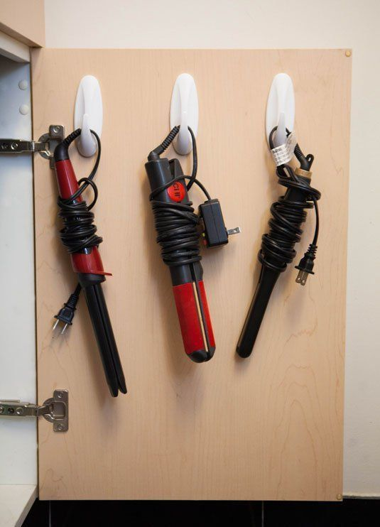 Use hooks on the back of a door to store & organise hair tools