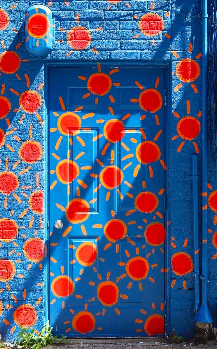 This doorway is so fun in Canada! All of the bright colors are a pop of fun in this town! Definitely want to travel to fun cities like this!