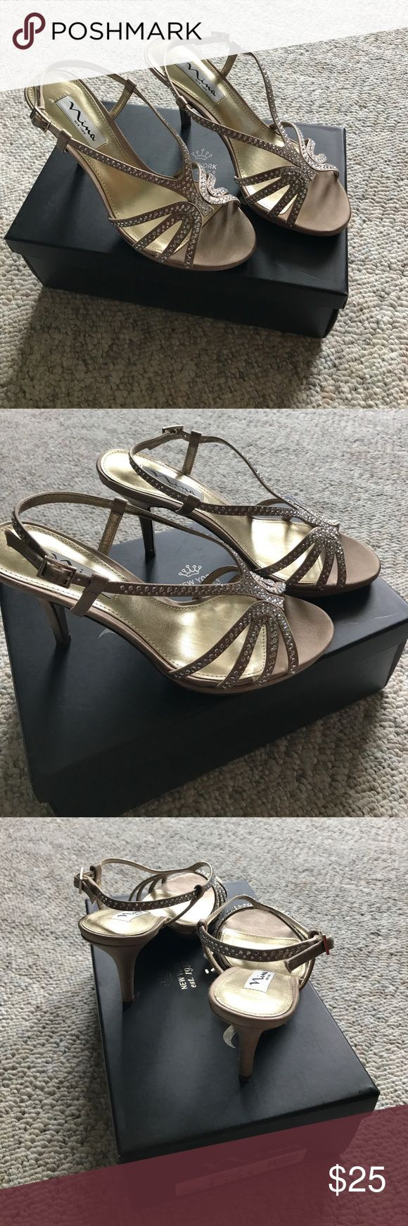 "Nina Bobbie Champagne Evening Sandals Nina Bobbie Evening Sandals feature sparkling rhinestone covered straps and a covered heel. Satin upper, Round-toe platform evening sandal with side buckle closure, 1/2"" platform, 3""  covered heel, man-made sole. Color: champagne Nina Shoes Heels"
