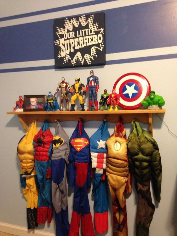 """Hang up a coat rack for all the kids super hero costumes and put a decal saying """"Hero Up"""" above it along with posters. Decorate wood letters with super hero paintings! So cool…you can also have customized superhero wall letters made! Hang up a wooden coat rack shelf for the costumes and out action figures …"""