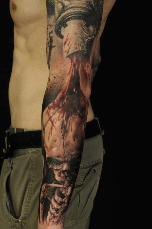 See more Blood and skull tattoos on arm