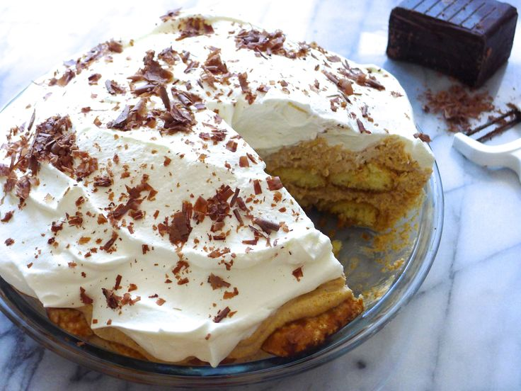 Gluten-Free Pumpkin Spice Tiramisu Pie : Impress holiday guests with something different this year, like this spicy pumpkin tiramisu, piled high with whipped cream. The center comes together with the help of mascarpone, pumpkin puree, pumpkin pie spice and gluten-free ladyfingers.