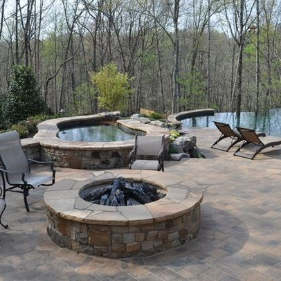A very nice use of cement brick pavers and walls to create an outdoor living area that blends well with the natural surroundings