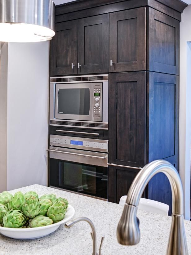 See this transitional kitchen with built-in microwave and oven on HGTV.com.