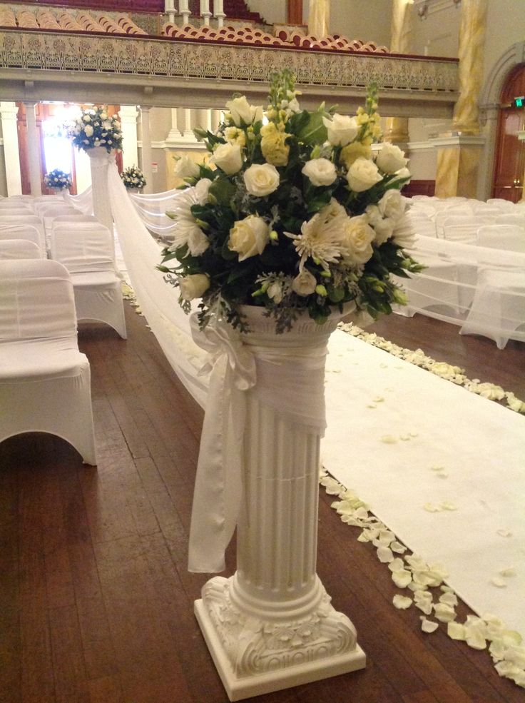 Flower arrangement on pillar column for wedding ceremony at Adelaide Town Hall. www.houseofthebride.com.au