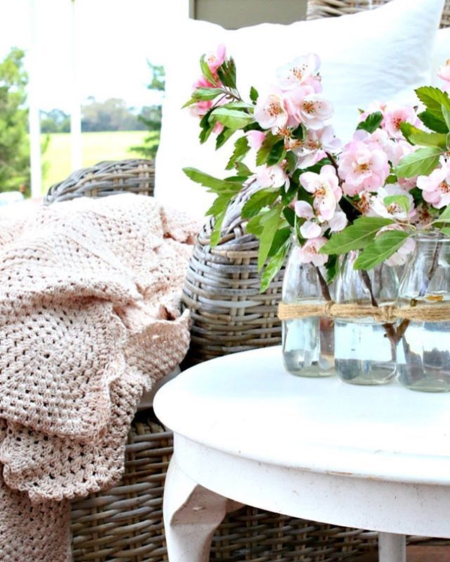 Pink Crab Apple blossom in a vase.  Provincial Home Living Chairs.
