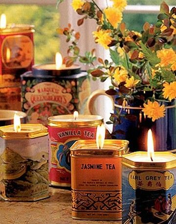 candles in tea tins... I think this is much prettier than the tea tin herb pins floating around - and I can much more easily burn something than grow something!!!!