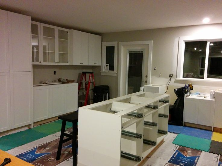 the kitchen cabinets being installed