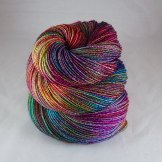 Commercially spun superwash merino∕nylon 4ply sock weight yarn, hand dyed by me using non-toxic acid dyes in a hand painted colour way. This yarn