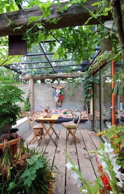 Boho Patio | Bohemian Outdoor Living love the black framed glass roof atop old posts and beam porch