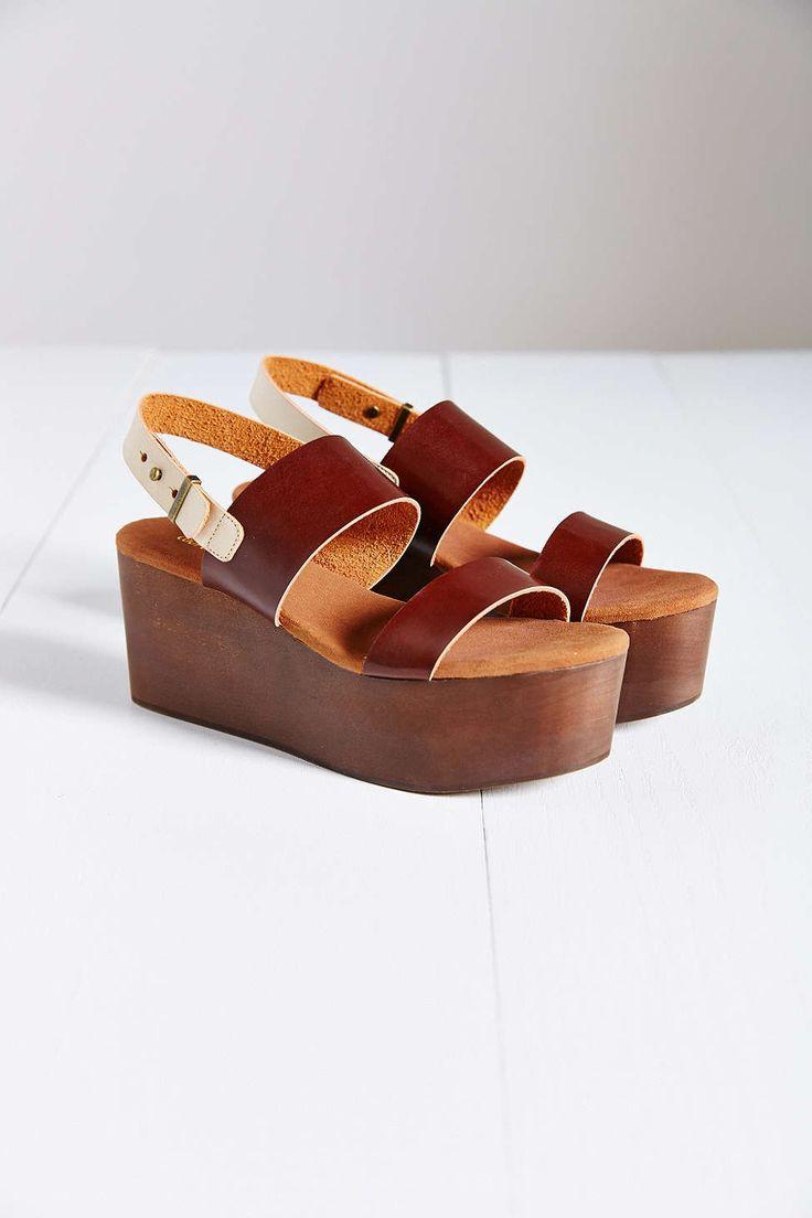 Cooperative Piper Wood-Botton Platform Sandal, $89; urbanoutfitters.com     - ELLE.com