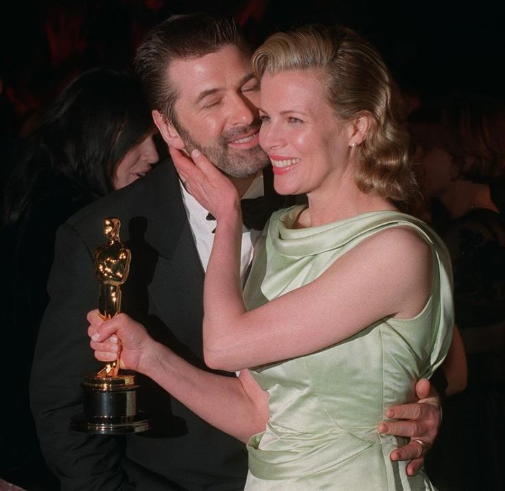 Kim Basinger getting affectionate with then-husband Alec Baldwin in 1998.