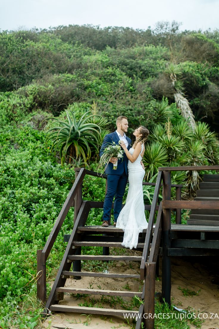 Beach wedding South Africa, green, navy blue suit.  http://www.absoluteperfection.co.za/#!CHANTELLE-AND-RJS-ROMANTIC-INTIMATE-BEACH-WEDDING/c1jar/57ad8b610cf2d58e4d0423e6
