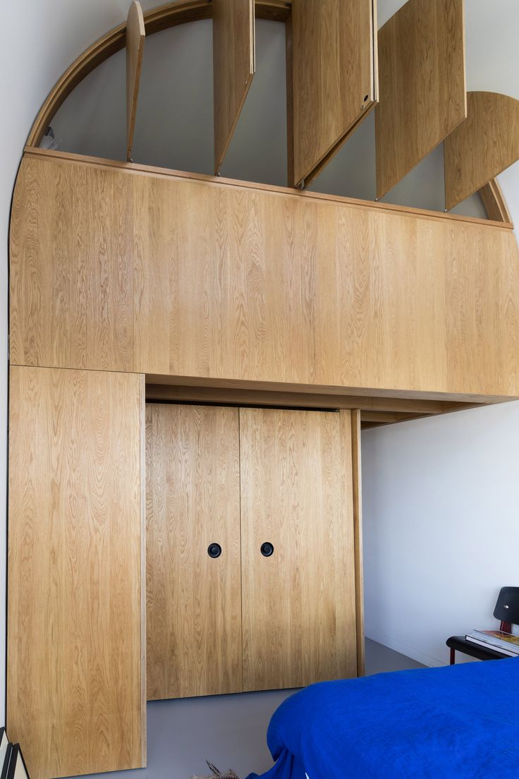 Francisco Sutherland Architects has slotted a timber structure containing a bathroom, mezzanine and wardrobes into a triplex apartment in London's brutalist Barbican Estate.