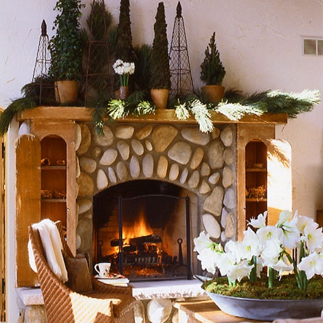 Beautiful, cozy fireplace!  http://vignettedesign.blogspot.com/2010/11/decking-halls-with-fresh-greens-and.html [ #mantel #mantle #display #ideas #fire #place #fireplace #rustic #lodge #northwoods ]
