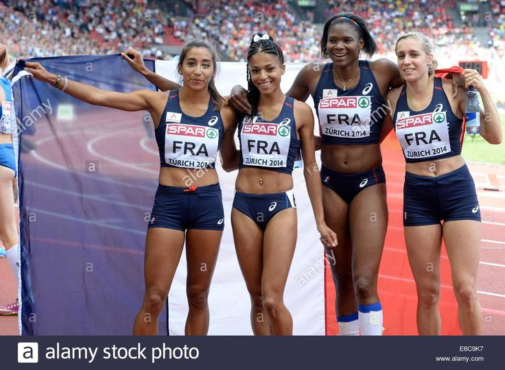 Download this stock image: epa04357910 (L-R) Agnes Raharolahy, Floria Guei, Muriel Hurtis and Marie Gayot of France cheer after winning the women's 4x400m relay final during the European Athletics Championships in the Letzigrund Stadium in Zurich, Switzerland, 17 August 2014.  EPA/STEFFEN SCHMIDT - E6C9K7 from Alamy's library of millions of high resolution stock photos, illustrations and vectors.