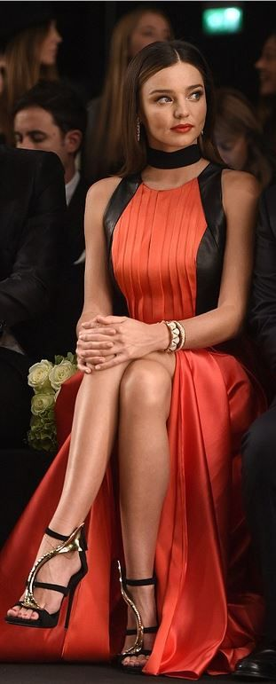 red pleated gown and black and gold sandals
