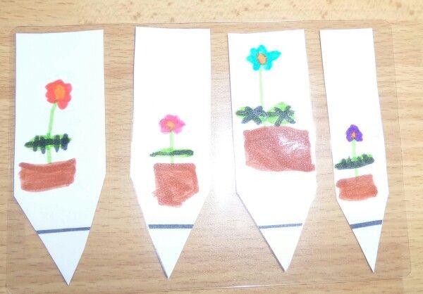 Etiquettes coupées, décorées et plastifiées pour nos jardinières. - Avril 2015