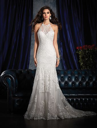 A stunning lace wedding gown with illusion halter strap over sweetheart neckline, sheath skirt, and chapel train.
