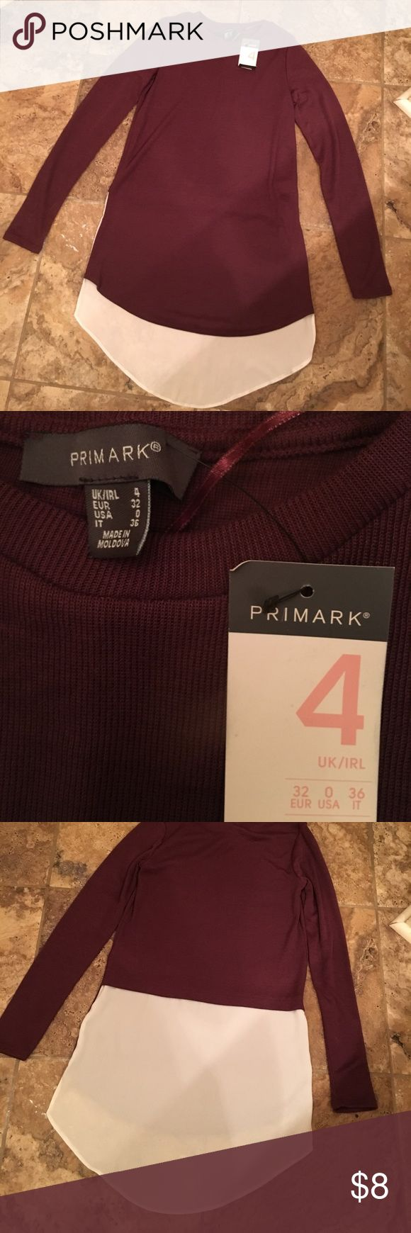 SOLD NWT Primark mixed media sweater Brand New with tags! Cute sweater with white chiffon blouse material in back. Length is longer in the back. Primark Sweaters