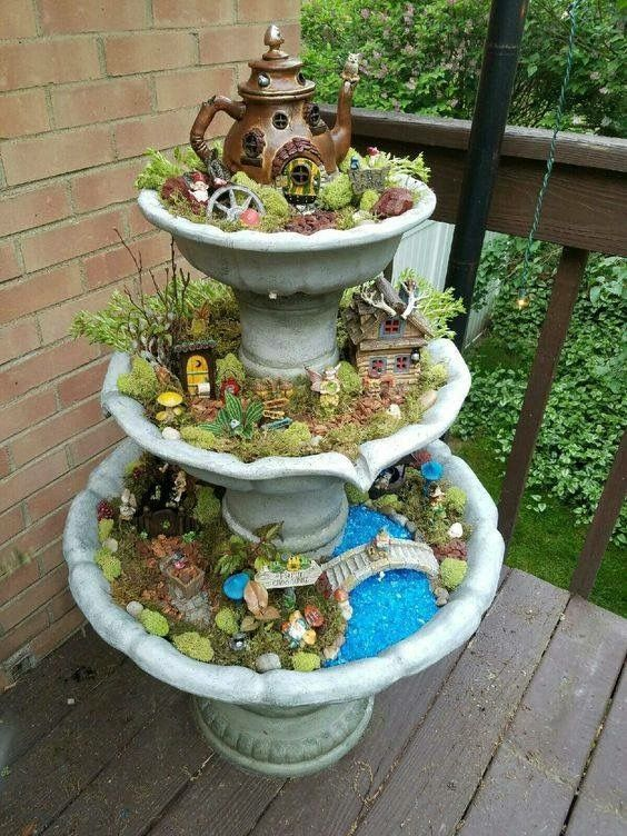 fairy garden in a multi tiered bird feeder