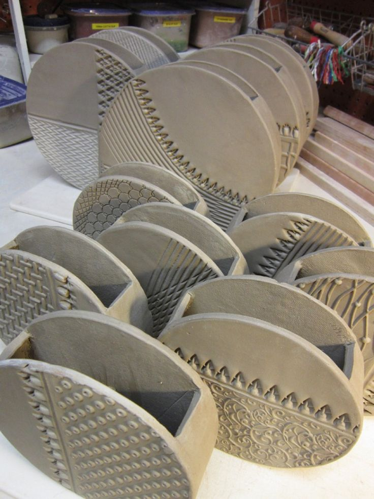 round slab vases. I'd put these on the wall, super cute with lucky bamboo in them.