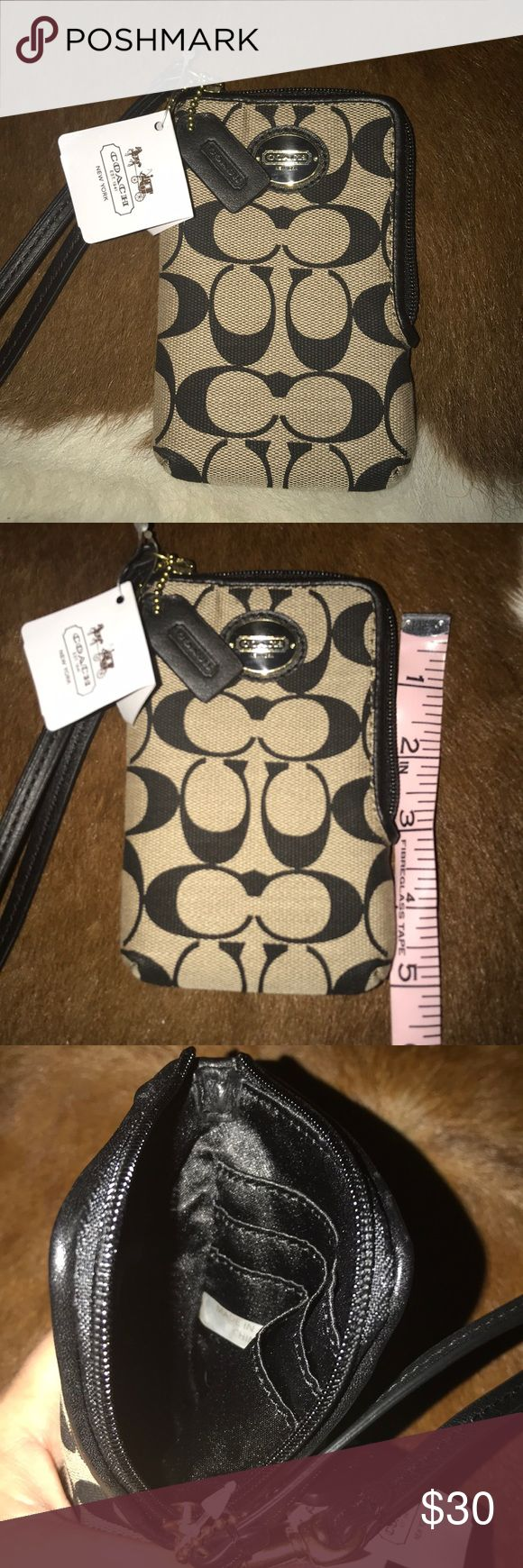 "Coach wristlet. Brand new Coach wristlet.  Has 3 credit card slots. Would fit a small I phone, 5"" long 3 1/2 wife. Black and Tan. Coach Bags Mini Bags"