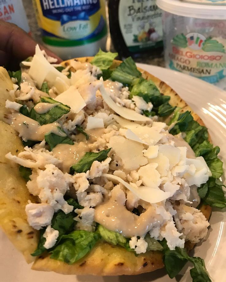 Chicken Caesar Salad inside a warm Garlic Butter Pita with Homemade Caesar Dressing. #macrofriendly -Joseph's pita sprayed with butter, sprinkled with garlic powder baked @400 5 mins -Spread spoonful dressing on warm pita -Handful chopped romaine lettuce, 6oz Hot chicken shredded -Dressing: 45g lowfat hellmans mayo, 30g fatfree balsamic, 5g grated Parmesan Asiago & Romano Cheese, 10g shaved @belgioiosocheese Asiago Romano Parmesan • 432 cal 8f/48c/42p