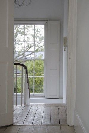 Sash windows,shutters,bare wood floors+banister...love it all.