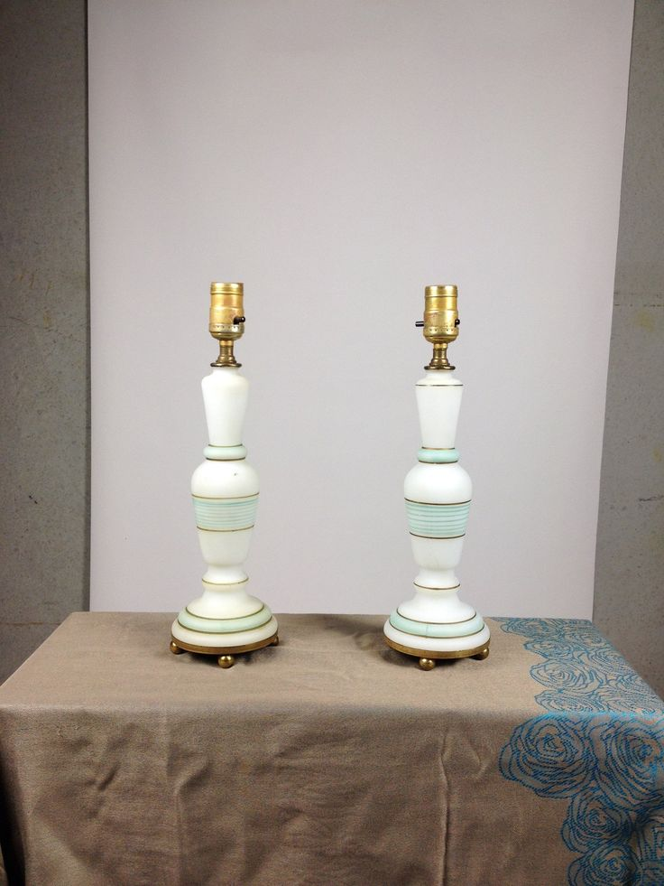 There's something so feminine and elegant about these American antique hand painted glass table lamps.  The comfortingly soft finish is a deliberate design - how sensible, of course bedside lamps should be pleasing to reach for in the dark.  These feature white frosted glass with hand painted bands in turquoise and gold on brass base.  Some cosmetic imperfections here and there from age & use. These pieces have been professionally rewired.